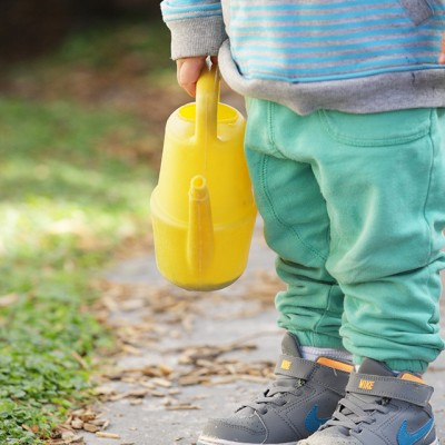 Childcare centre child with yellow watering can